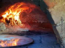 Pizza und Brot aus dem Holzhofen
